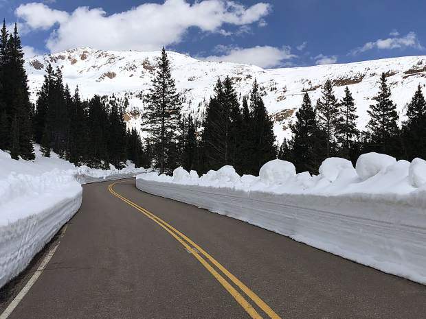 The snow is melting rapidly in the Highway 82 corridor on Independence Pass but snow banks an estimated 5 feet high still line the shoulders. The road is clear for the annual Ride for the Pass fundraiser.