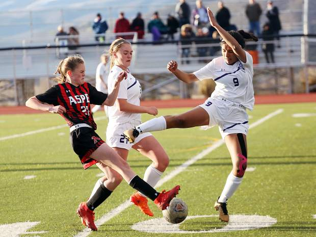 Basalt High School's Jazmin Calzada, right, puts pressure on Aspen's Jenny Ellis as BHS teammate Josie Day tries to stay out of the way in the girls soccer game Friday, May 3, 2019, on the AHS turf. The teams played to a surprising 2-2 draw in what was senior day for the Skiers. (Photo by Austin Colbert/The Aspen Times).