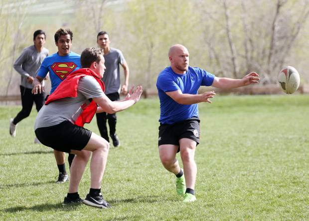 Aspen Junior Gents rugby coach Zach Hendrix makes a pass duirng a team practice earlier this season at their home field in Willits. (Photo by Austin Colbert/The Aspen Times).