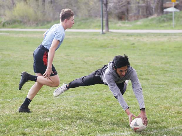 The Aspen Junior Gents rugby team practices earlier this season at their home field in Willits. (Photo by Austin Colbert/The Aspen Times).