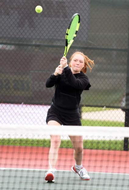 Aspen's Bliss Pekkala hits the ball as she plays in the No. 1 doubles match on Friday at the State 3A Tennis tournament on the Centennial Park tennis courts in Greeley.
