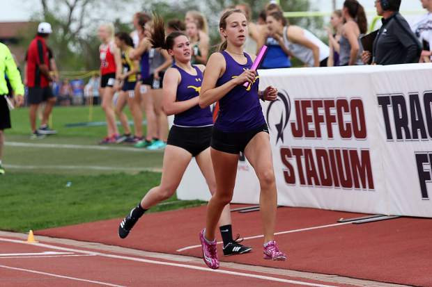 Basalt High School's Lily Gillis, front, recieves the baton from teammate Maddie Ellison in the girls 4x800-meter relay finals at the state track and field meet on Thursday, May 16, 2019, in Lakewood.
