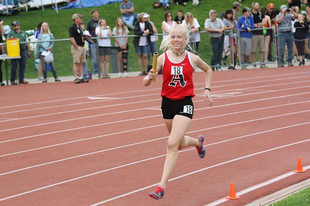 Aspen High School sophomore Kendall Clark competes in the girls 4x800-meter relay finals at the state track and field meet on Thursday, May 16, 2019, in Lakewood.