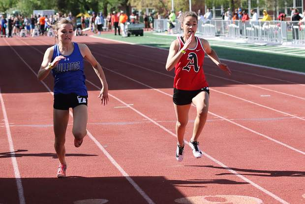 Aspen High School's Julisa Ruiz-Vega, right, competes in the 100-meter dash at the 3A Western Slope League track and field championships over the weekend in Grand Junction.