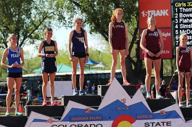 Basalt High School sophomore Sierra Bower stands on the podium after taking second to Classical Academy's Kaylee Thompson in the 3A girls 3,200-meter race at the state track and field championships on Friday, May 17, 2019, in Lakewood.