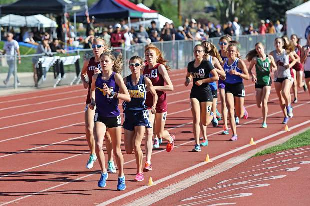 Basalt High School sophomore Sierra Bower briefly leads in the 3A girls 3,200-meter race at the state track and field championships on Friday, May 17, 2019, in Lakewood.