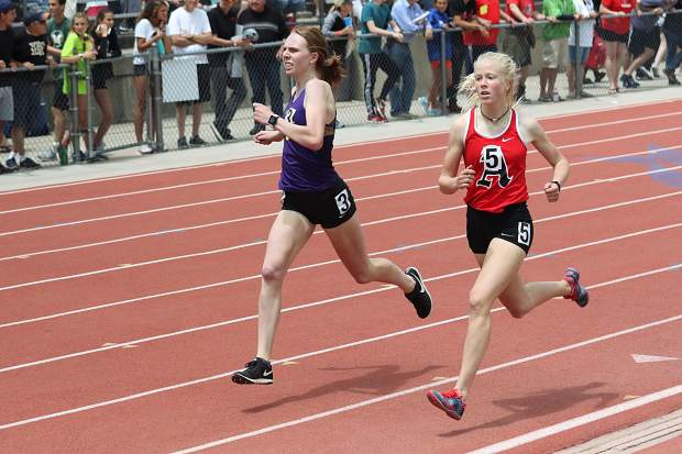 Basalt High School senior Megan Maley, left, and Aspen sophomore Kendall Clark compete in the 3A girls 800-meter race at the state track and field championships on Friday, May 17, 2019, in Lakewood.