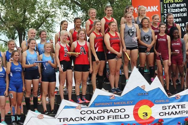 The Aspen High School girls 800-meter sprint medley team stands on the podium after taking fourth at the state track and field championships on Friday, May 17, 2019, in Lakewood.