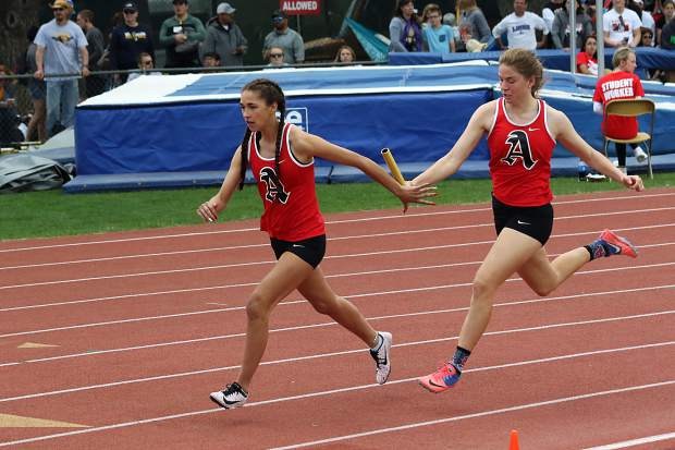 Aspen High School junior Julisa Ruiz-Vega recieves the baton from senior teammate Lexi Ferlisi in the 3A girls sprint medley at the state track and field championships on Friday, May 17, 2019, in Lakewood.