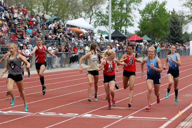 Aspen High School sophomore Kendall Clark recieves the baton from sophomore teammate Zuleika Hanson in the 3A girls sprint medley at the state track and field championships on Friday, May 17, 2019, in Lakewood.