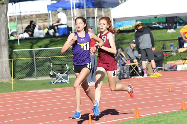Basalt High School sophomore Sierra Bower briefly leads Classical Academy's Kaylee Thompson in the 3A girls 3,200-meter race at the state track and field championships on Friday, May 17, 2019, in Lakewood. Thompson won the race by about a stride over Bower.