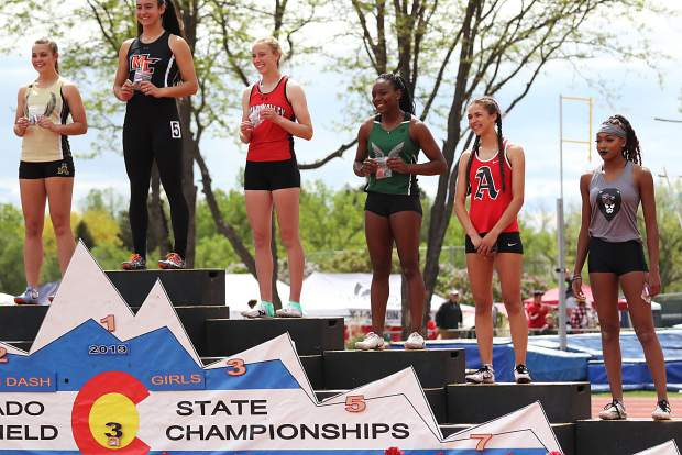 Aspen High School junior Julisa Ruiz-Vega stands on the podium after taking seventh in the girls 100-meter dash finals on Saturday at the state track and field championships in Lakewood.