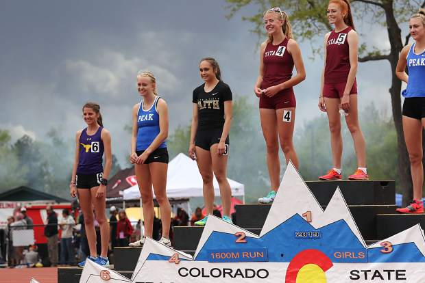 Basalt High School sophomore Sierra Bower stands on the podium after taking eighth in the girls 1,600-meter run finals on Saturday at the state track and field championships in Lakewood.