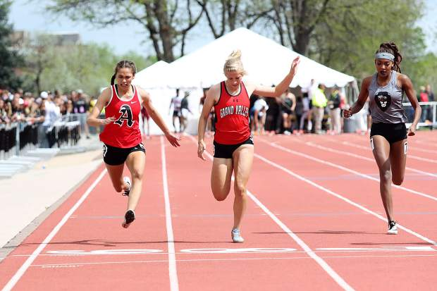 Aspen High School junior Julisa Ruiz-Vega, left, competes in the girls 100-meter dash finals on Saturday at the state track and field championships in Lakewood.