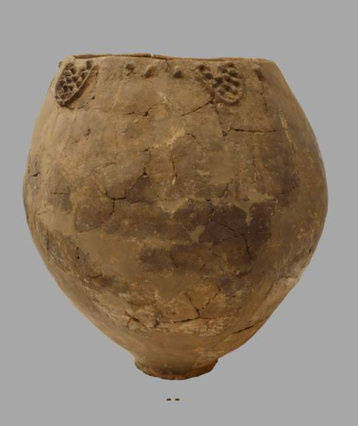 This clay jar is an example of an ancient winemaking vessel used by Georgians to ferment and age wines.
