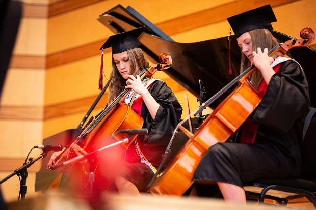 Students Sophia Chase and Tate Randel accompany Brooke Leibeinger and Clara Maxwell (not pictured) in a performance during Aspen High School's graduation Saturday.
