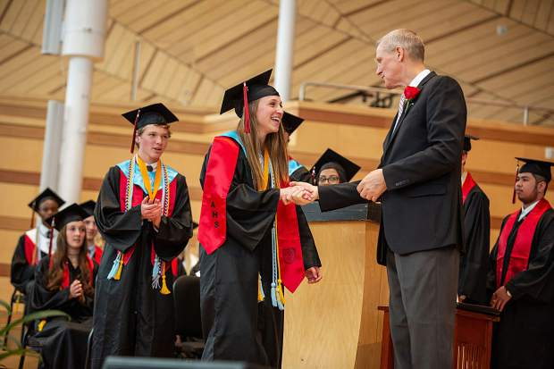 Co-Salutatory Sophia Springfield shakes the hand of Aspen School District's Superintendent Dr. John Maloy at graduation day Saturday.