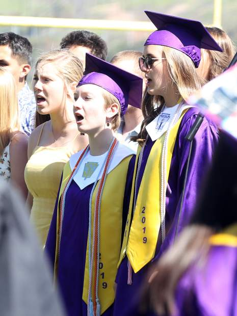 Members of the chamber choir sing during the Basalt High School graduation ceremony on Saturday, June 1, 2019, on the BHS football field. (Photo by Austin Colbert/The Aspen Times)