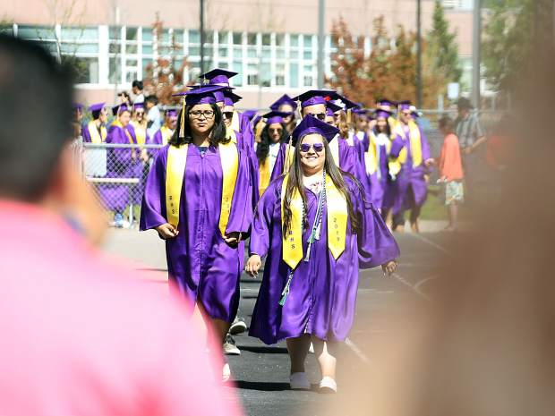 Students arrive during the processional for the Basalt High School graduation ceremony on Saturday, June 1, 2019, on the BHS football field. (Photo by Austin Colbert/The Aspen Times)