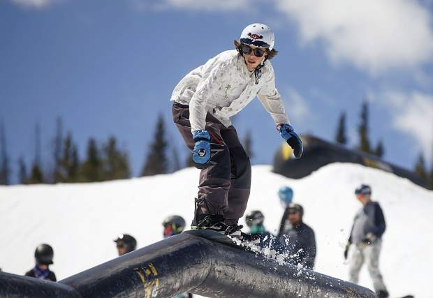 A snowboarder rides a rail at Woodward Copper's Pipeline Park on Wednesday, June 12, at Copper Mountain Resort.