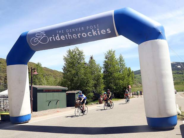 Cyclists cross the finish line on Day 3 of Ride the Rockies on Tuesday, June 11, 2019, near the Rodeo Lot in Snowmass Village. (Photo by Austin Colbert/The Aspen Times)