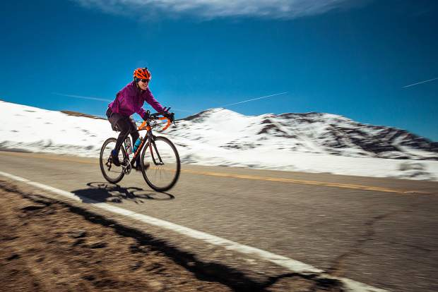 A cyclist makes her way over Independence Pass on day three of Ride the Rockies Tuesday.