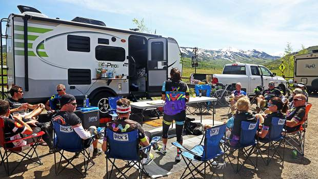 The Wish for Wheels cycling club hosts a hospitality session after Day 3 of Ride the Rockies on Tuesday, June 11, 2019, near the Rodeo Lot in Snowmass Village. (Photo by Austin Colbert/The Aspen Times)