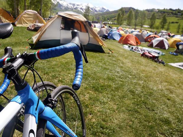 A tent village was erected after Day 3 of Ride the Rockies on Tuesday, June 11, 2019, near the Rodeo Lot in Snowmass Village. (Photo by Austin Colbert/The Aspen Times)