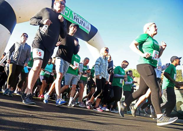 Participants take off from the start line of the Food & Wine 5k charity run on Friday at Rio Grande Park in Aspen.