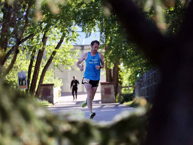 Carbondale's Jeremy Duncan competes in the Food & Wine 5k charity run on Friday. He finished second.