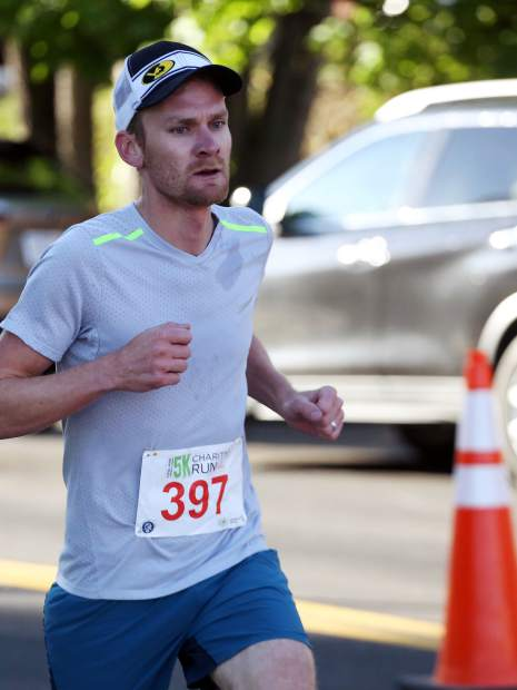 Third-place finisher Craig Lewis competes in the Food & Wine 5k charity run on Friday.