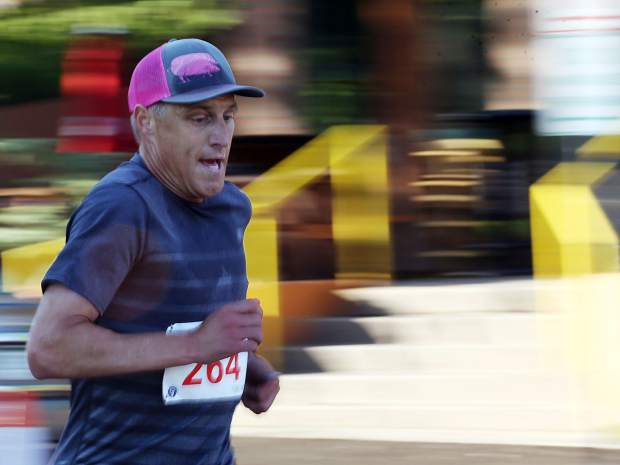 Chef Bobby Stuckey, of Boulder, competes in the Food & Wine 5k charity run on Friday.