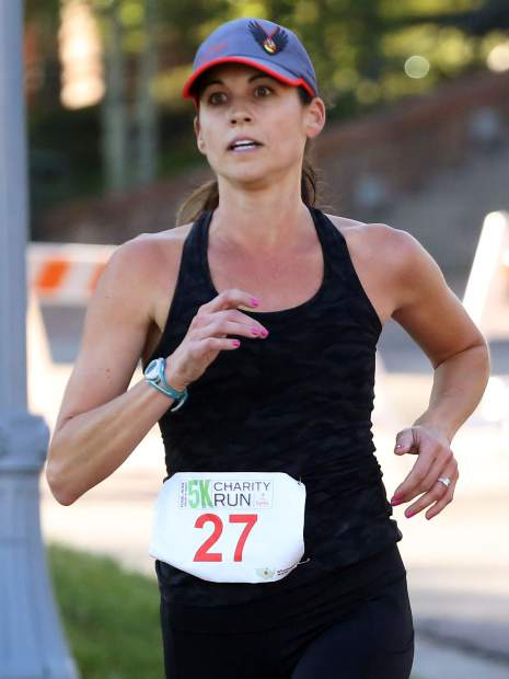 Jaclyn Blumberg, of California, won the women's side of the Food & Wine 5k charity run on Friday.