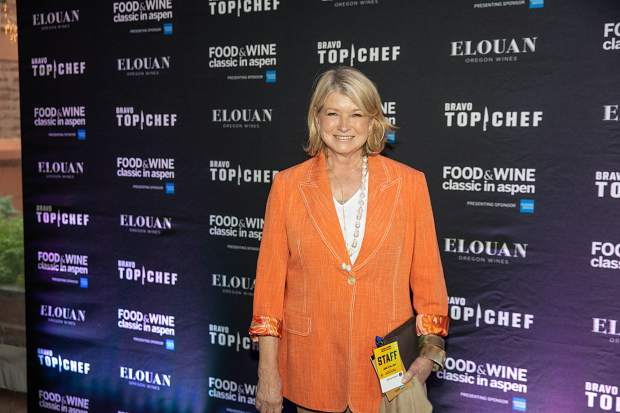 Martha Stewart poses on the red carpet Thursday night during a brief stop at the Food & Wine Classic Welcome Reception.