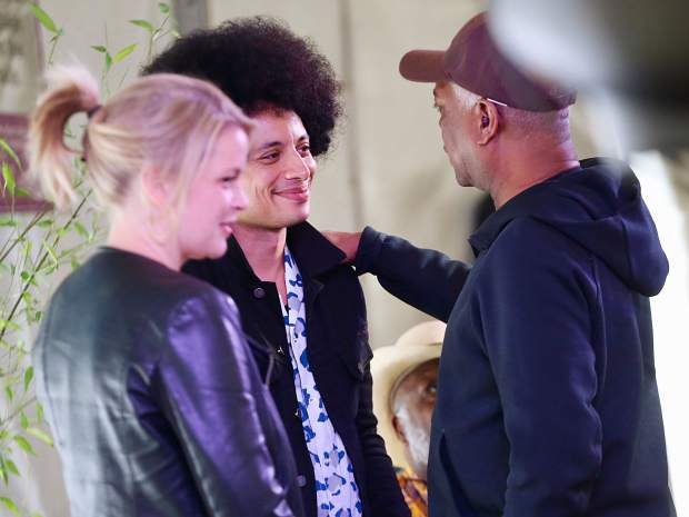 Jazz icon Booker T. Jones, right, says a few words to up-and-coming star Jose James as Canadian artist Bria Skonberg looks on following a panel discussion Saturday, June 22, 2019, inside the VIP tent in Aspen. The panel, which also included Blues legend Taj Mahal, was a first time joint venture between Jazz Aspen Snowmass and the Aspen Ideas Festival. (Photo by Austin Colbert/The Aspen Times)