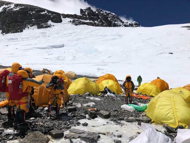 This May 21, 2019, photo provided by climber Dawa Steven Sherpa shows Camp Four, the highest camp on Mount Everest littered with abandoned tents. The record number of climbers on Mount Everest this season has left a cleanup crew grappling with how to clear away everything from abandoned tents to human waste that threatens drinking water. (Dawa Steven Sherpa/Asian Trekking via AP)
