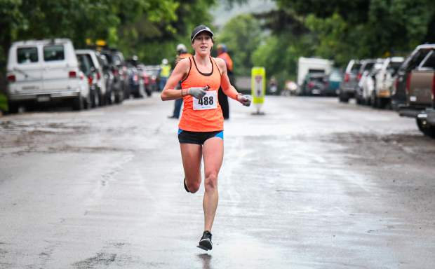 Kate Phillips makes her way to the finish line of the Strawberry Shortcut 10K on a cold and wet Sunday morning.