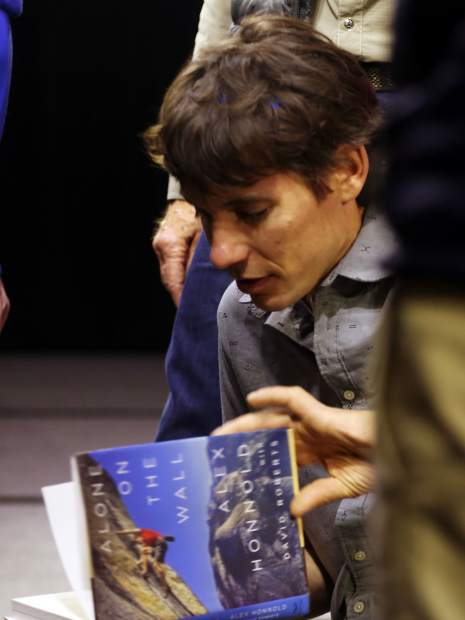 Climber Alex Honnold signs autographs after talking during an Aspen Ideas Festival discussion on Monday, June 24, 2019, inside the St. Regis hotel in Aspen. (Photo by Austin Colbert/The Aspen Times)