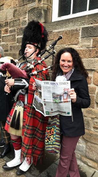 "Reader Laura Seay brought The Aspen Times with her to Edinburgh, Scottland, ""and and my mom snapped this pic with me + a cute Scotsman,"" she reported."