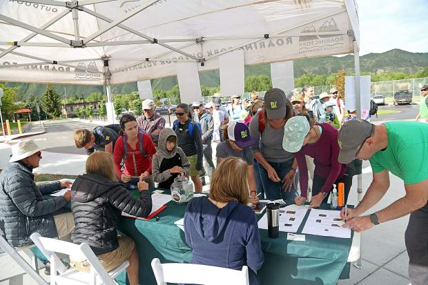 Volunteers register at Basalt Middle School to help with a reseeding effort on Basalt Mountain on Saturday, June 16, 2019. (Photo by Austin Colbert/The Aspen Times)