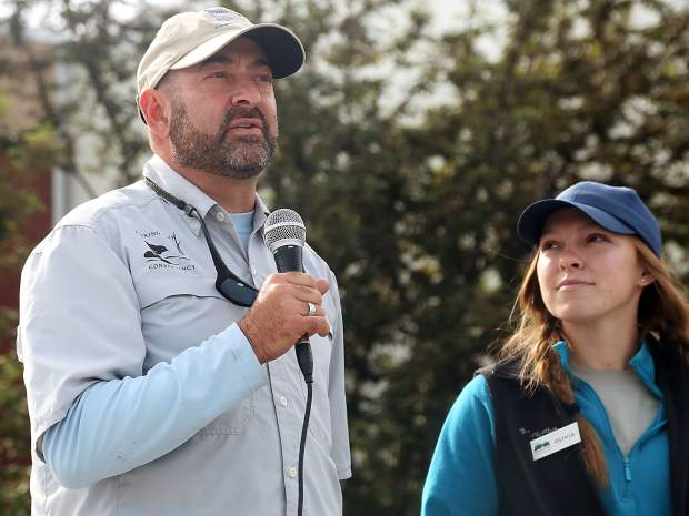Rick Lofaro, the executive director of Roaring Fork Conservancy, talks while Olivia Deihs, the program manager at Roaring Fork Outdoor Volunteers, listens prior to a Basalt Mountain reseeding effort Saturday, June 16, 2019, at Basalt Middle School. (Photo by Austin Colbert/The Aspen Times)