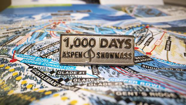 The 98 people who were skiing or riding at least 100 days for each of the last 10 seasons will receive this special 1,000-day pin from Aspen Skiing Co.