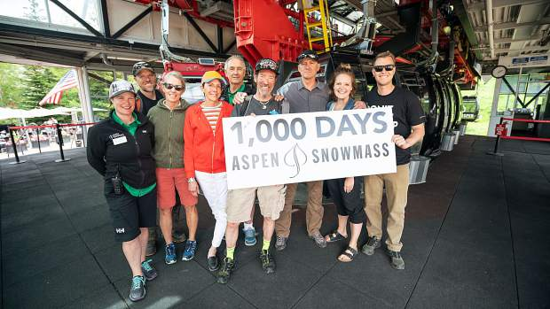 Mikey Wechsler, center, with green socks, was recognized by Aspen Mountain Manager J.T. Welden, third from right, and other Skico employees for hitting the slopes 1,000 days over the last 10 seasons.