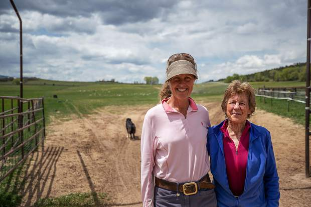 Bridget (left) and Kit Strang on their family ranch in Missouri Heights.Sheep and sheepdogs are part of the pastoral setting.