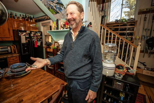 Master Sommelier Jay Fletcher holds one of his wine openers at his home on Juan Street in Aspen.