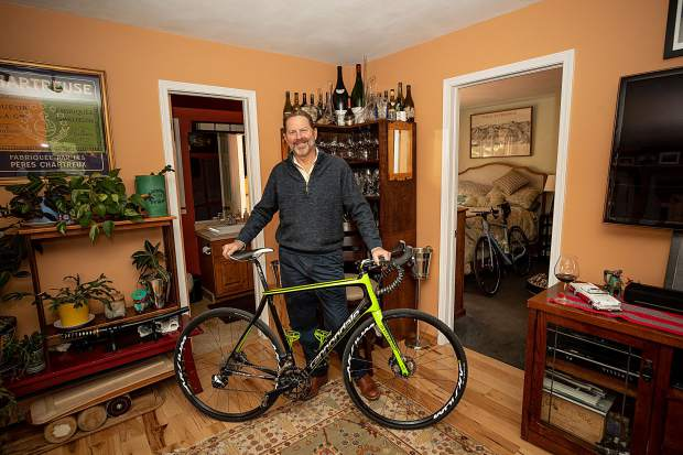 Master Sommelier Jay Fletcher with one of his favorite bikes at his home on Juan Street in Aspen.