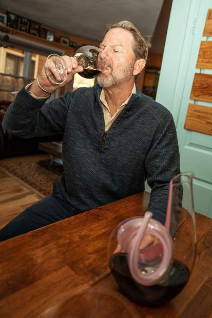 Master Sommelier Jay Fletcher tastes a glass of wine at his home on Juan Street in Aspen.