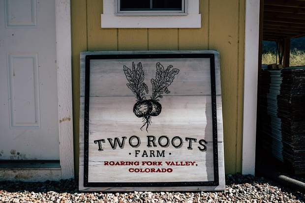 The Two Roots Farm sign outside a shed in Emma.