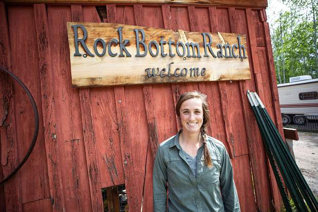 Rock Bottom Ranch Agriculture Manager Alyssa Barsanti stands at the entrance to the ranch owned and operated by Aspen Center for Environmental Studies.