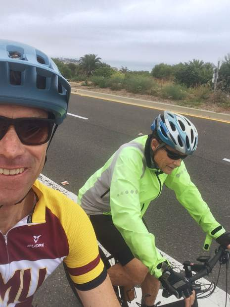 Scott Mercier goes on a bike ride with his father.